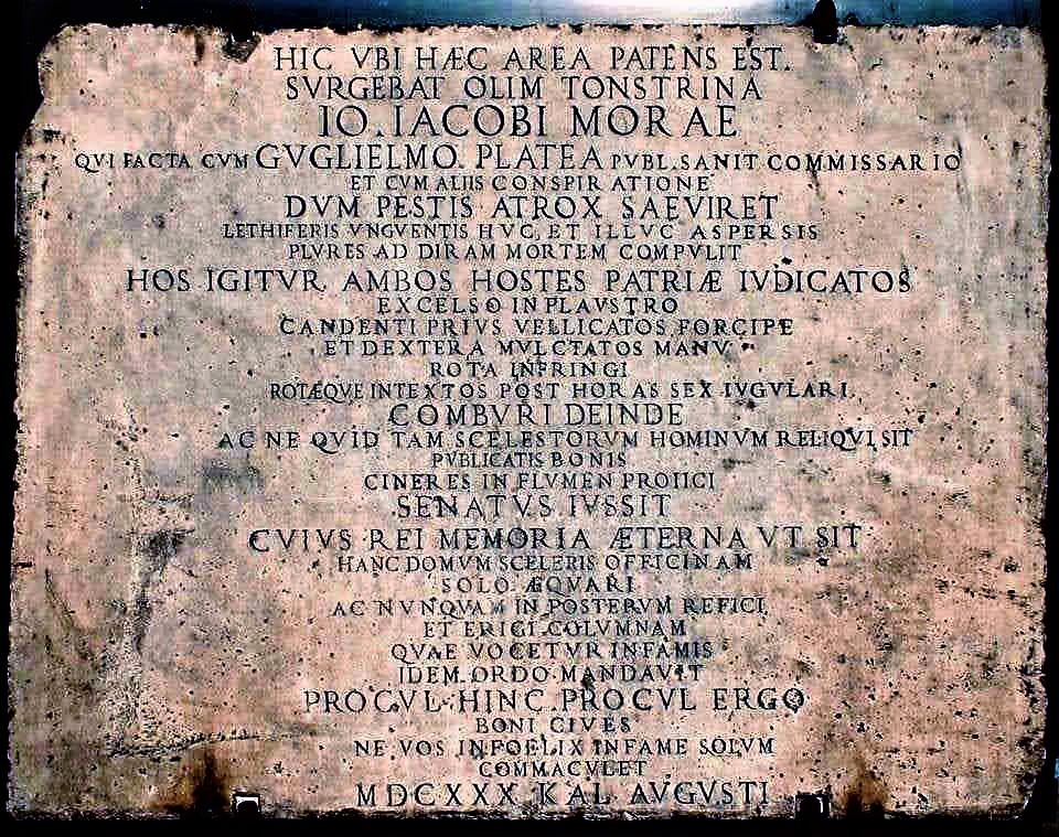 Lapide di monito affisso sul muro della casa vicino alla Colonna Infame